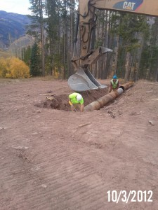Installing snowmaking pipe