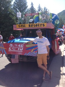 Benjamin in front of the Vail Resorts float.