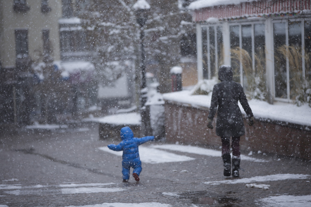 Snowing in Vail Village mother and son Andrew Taylor
