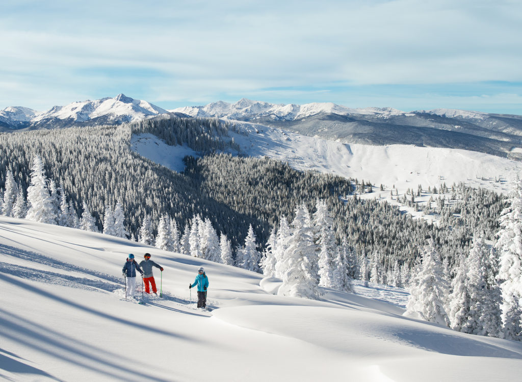 Skiers pause to soak in a beautiful bluebird day in the back bowls of Vail.