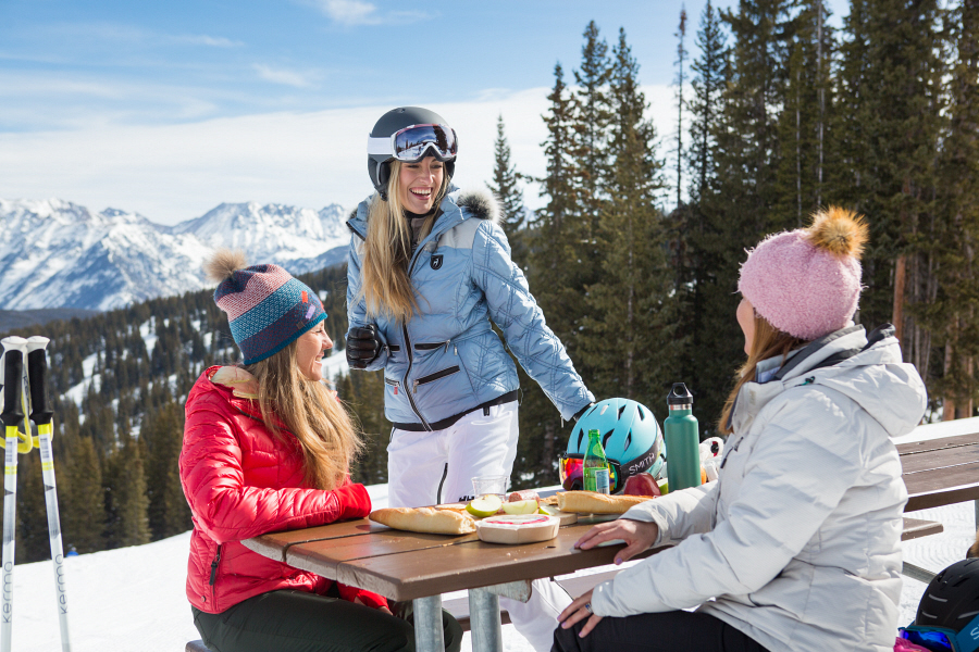 Friends sample skiing, shopping and apres at Vail.