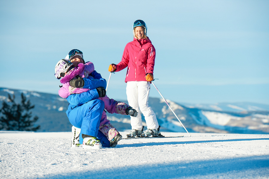 A mother, daughter and Vail ski school instructor take a pause from instruction to goof around on the snowy slopes.